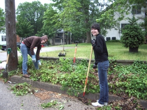 Interns Jackie McGraw & Sarah Leone install the food shelf garden at Mary Hanson's home.